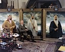 With finished paintings of the three kings of Saudi Arabia